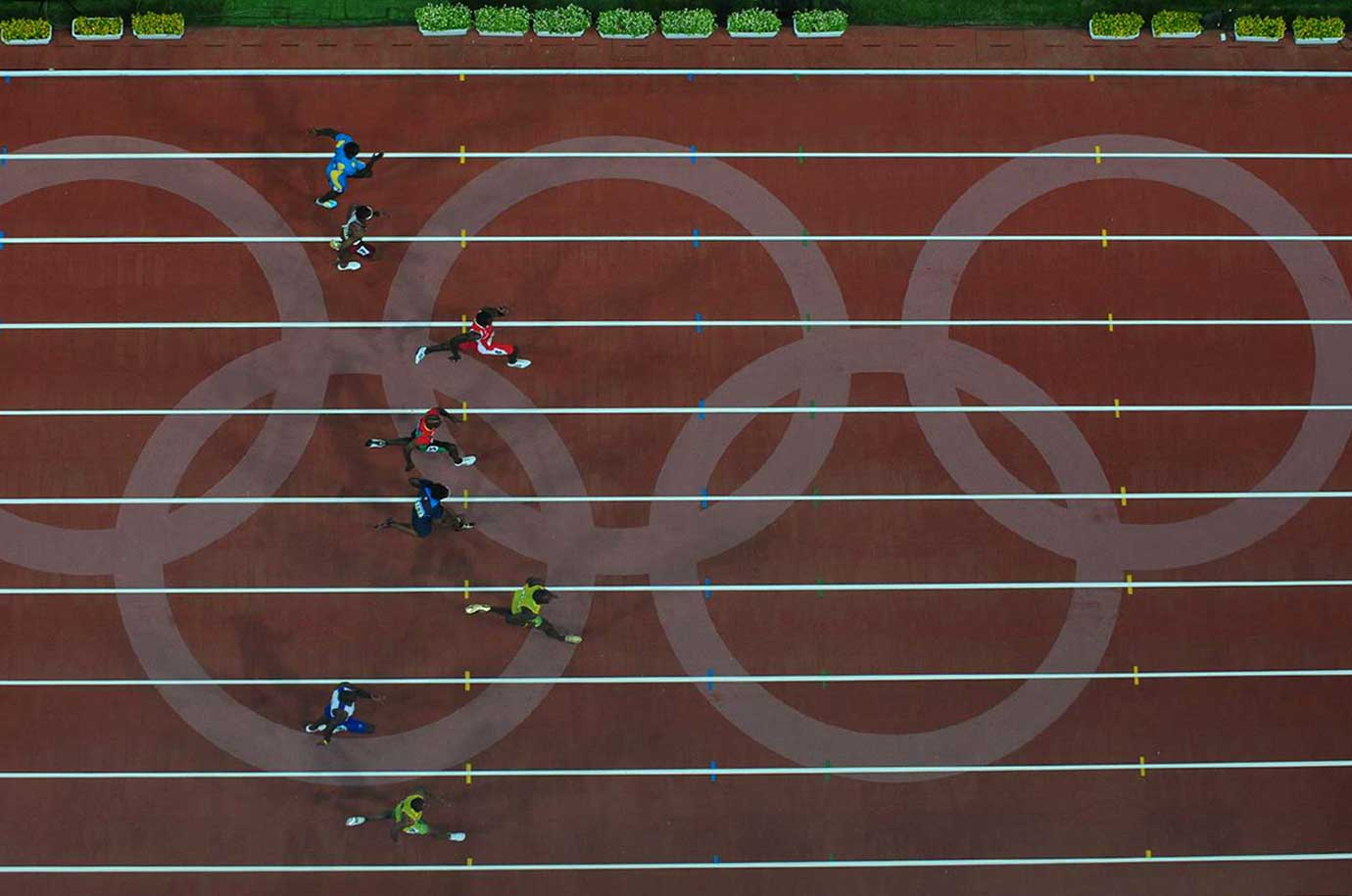 Usain Bolt of Jamaica leading the field in a 100-meter semifinal at the 2008 Beijing Olympic Games.