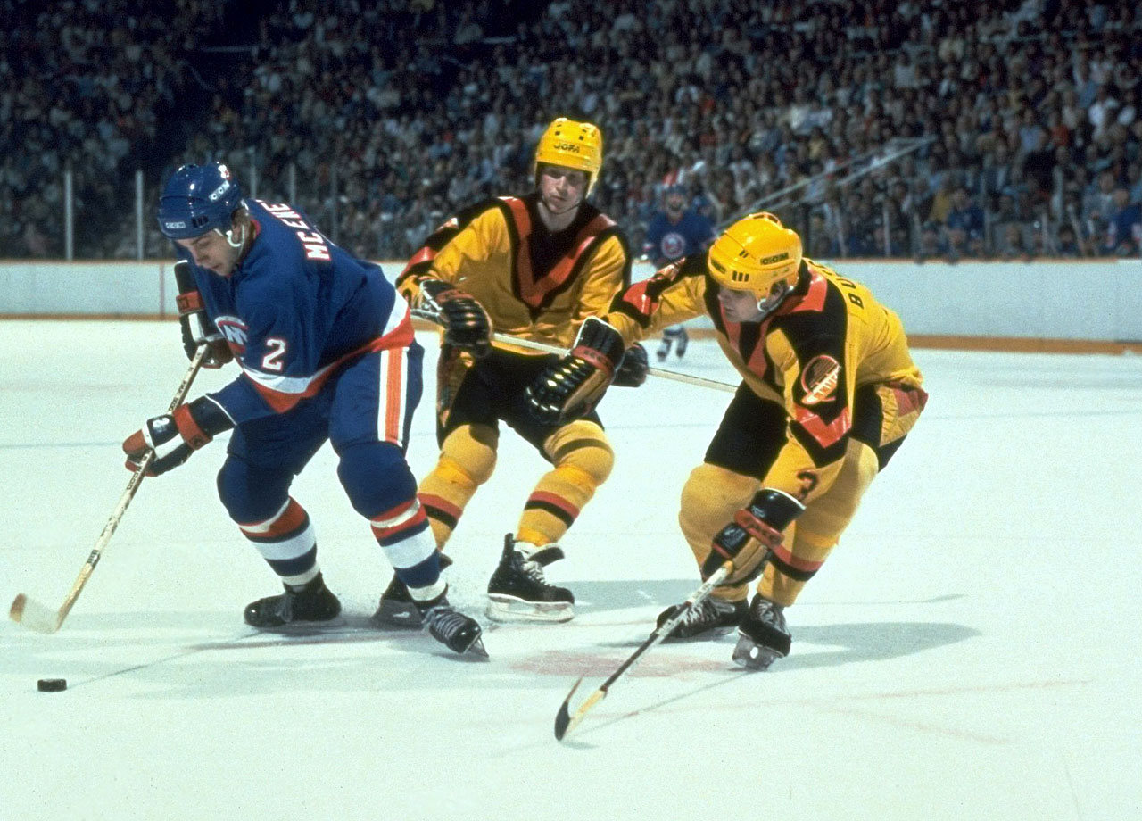This beaming yellow sweater with deep black and red V neckline instead of an actual logo was the first of many ill-conceived designs trotted out by the franchise. Many fans revere it as an important part of the Canucks' history. And this is why that team can't have nice things to wear.