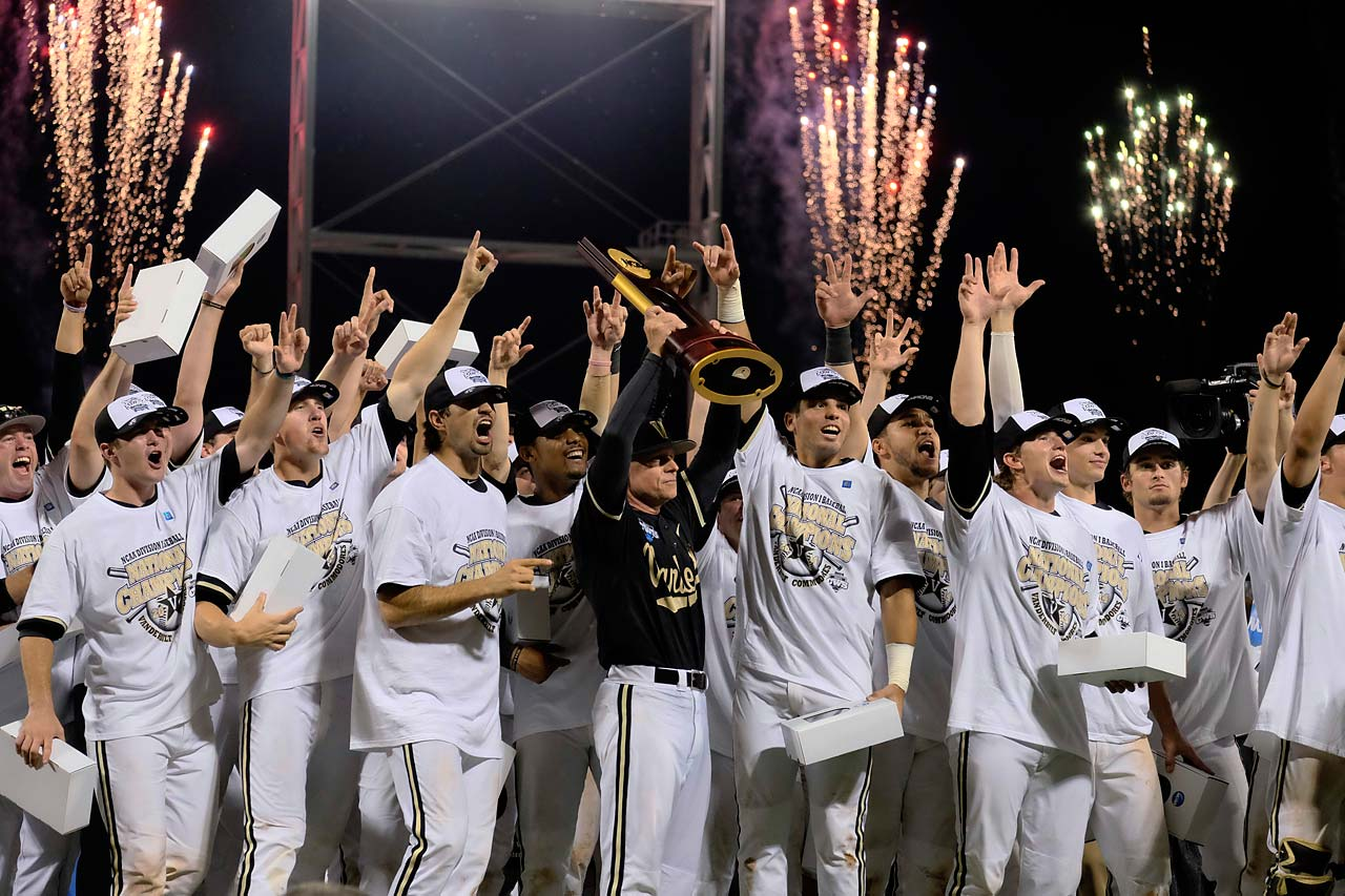 Vanderbilt raises the championship trophy with fireworks going off in the background at the College World Series.  It was a momentous occasion in the school's history because it's the first national championship the Commodores have won in any sport.