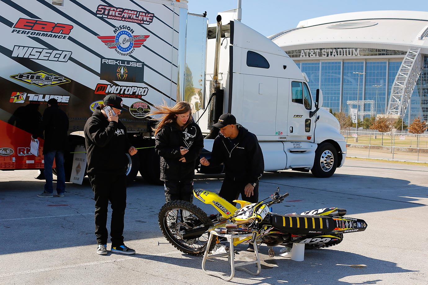 Golden talks with team personnel Frankie Garcia and Tim Slayton as they work on her bike prior to race.