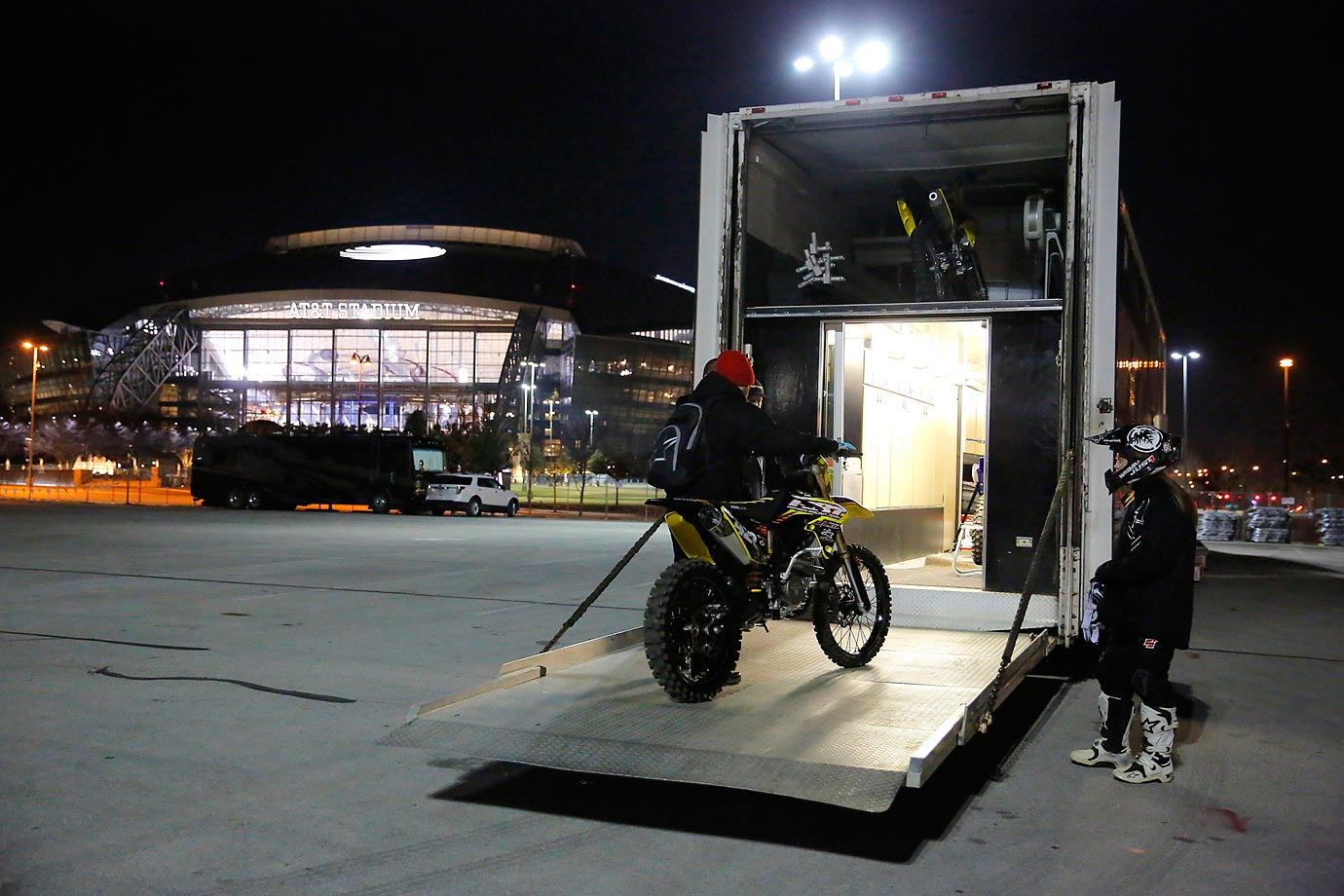 Golden prepares her bike to go for predawn practice runs at the AT&T Stadium.