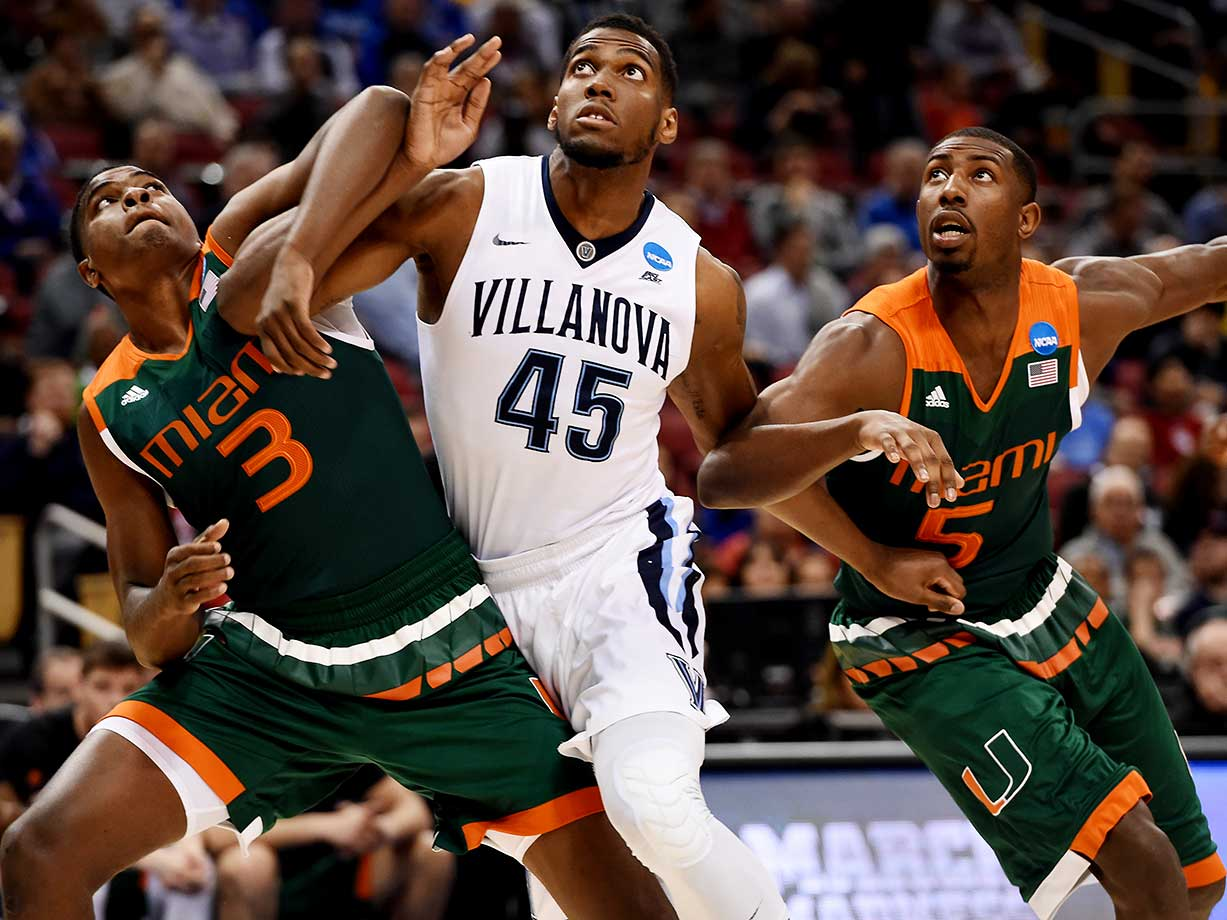 Anthony Lawrence Jr. (3) and teammate Davon Reed attempt to keep Villanova's Darryl Reynolds from getting to the ball.