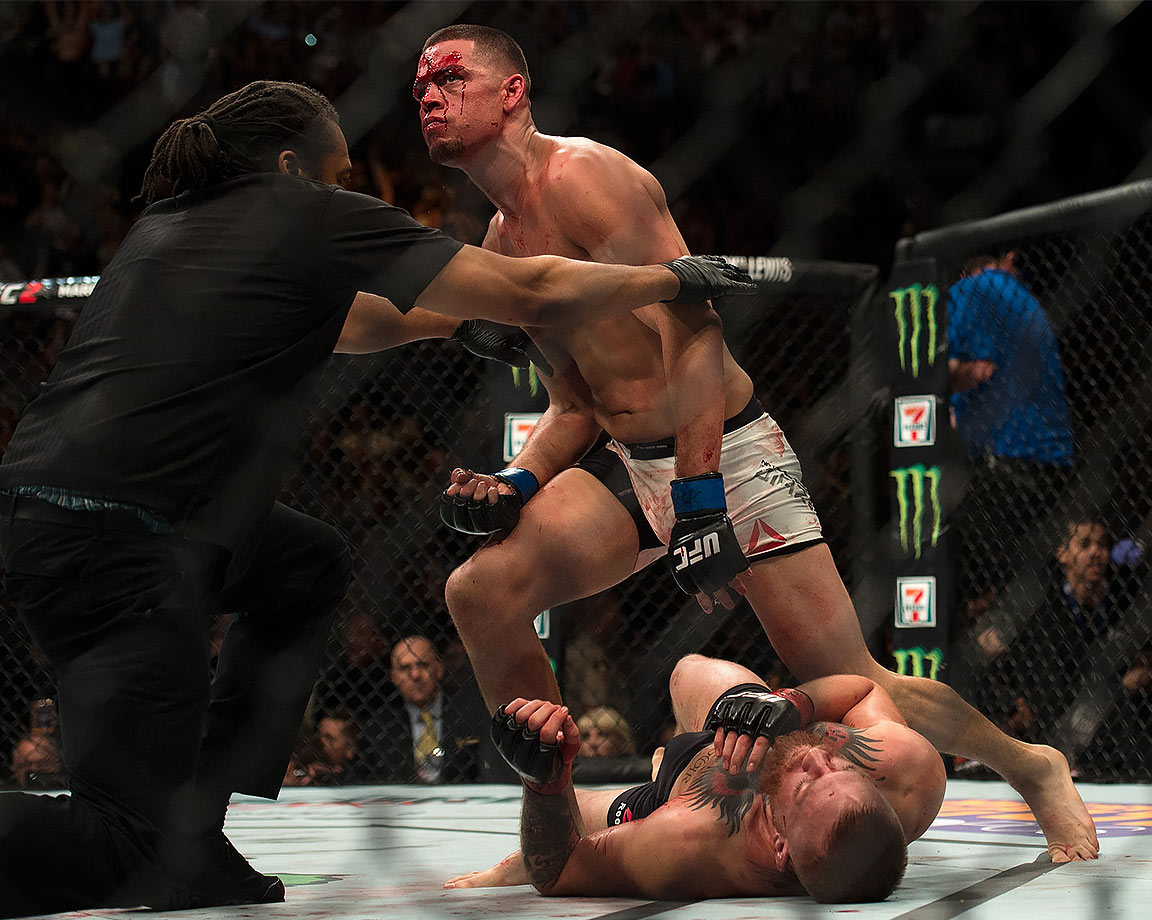 Nate Diaz (top) submits Conor McGregor in their welterweight bout during the UFC 196 in the MGM Grand Garden Arena on March 5, 2016 in Las Vegas, Nevada.