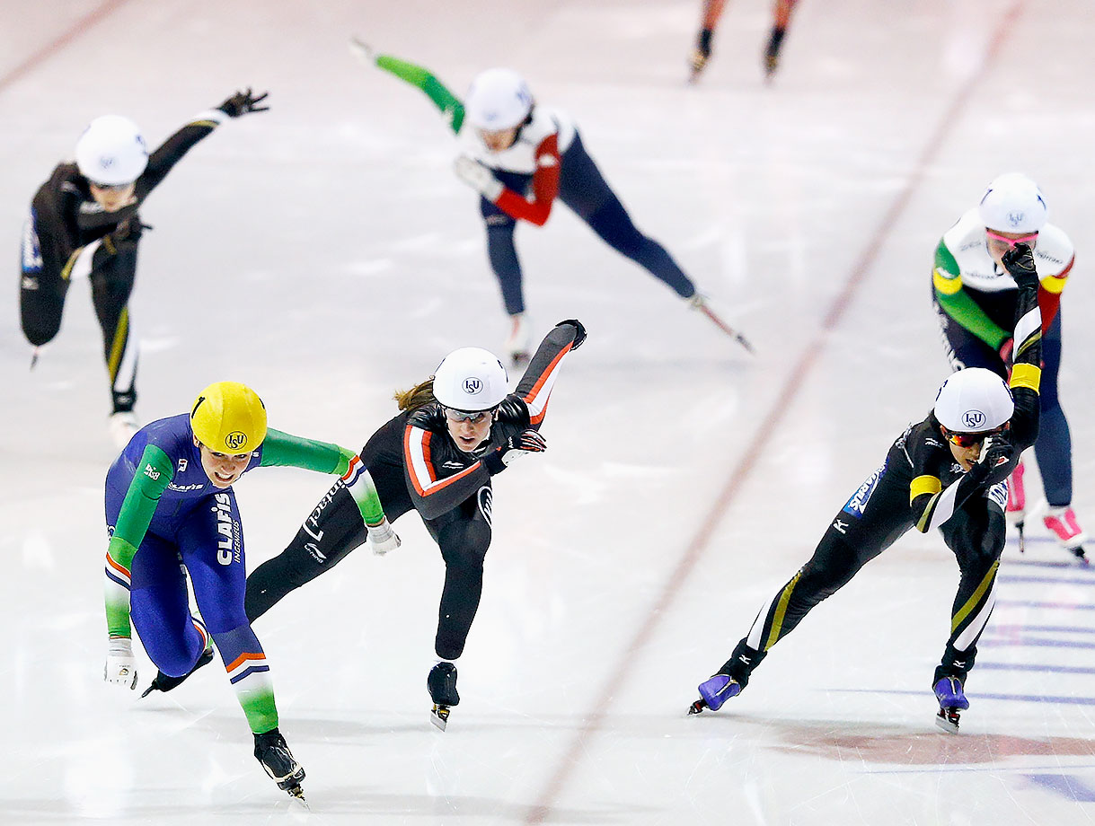 Irene Schouten (yellow helmet) of the Netherlands leads the pack in the mass start women's speedskating race during Day 3 of the ISU World Cup Speed Finals in Heerenveen, the Netherlands.