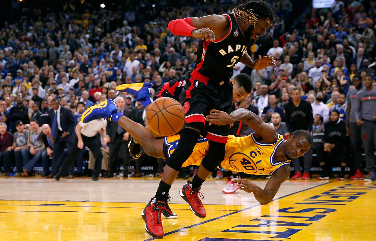 Harrison Barnes dives to save the ball from going out of bounds against Toronto in a game in which the Warriros donned their throwback The City uniforms for the first time in over eight years.