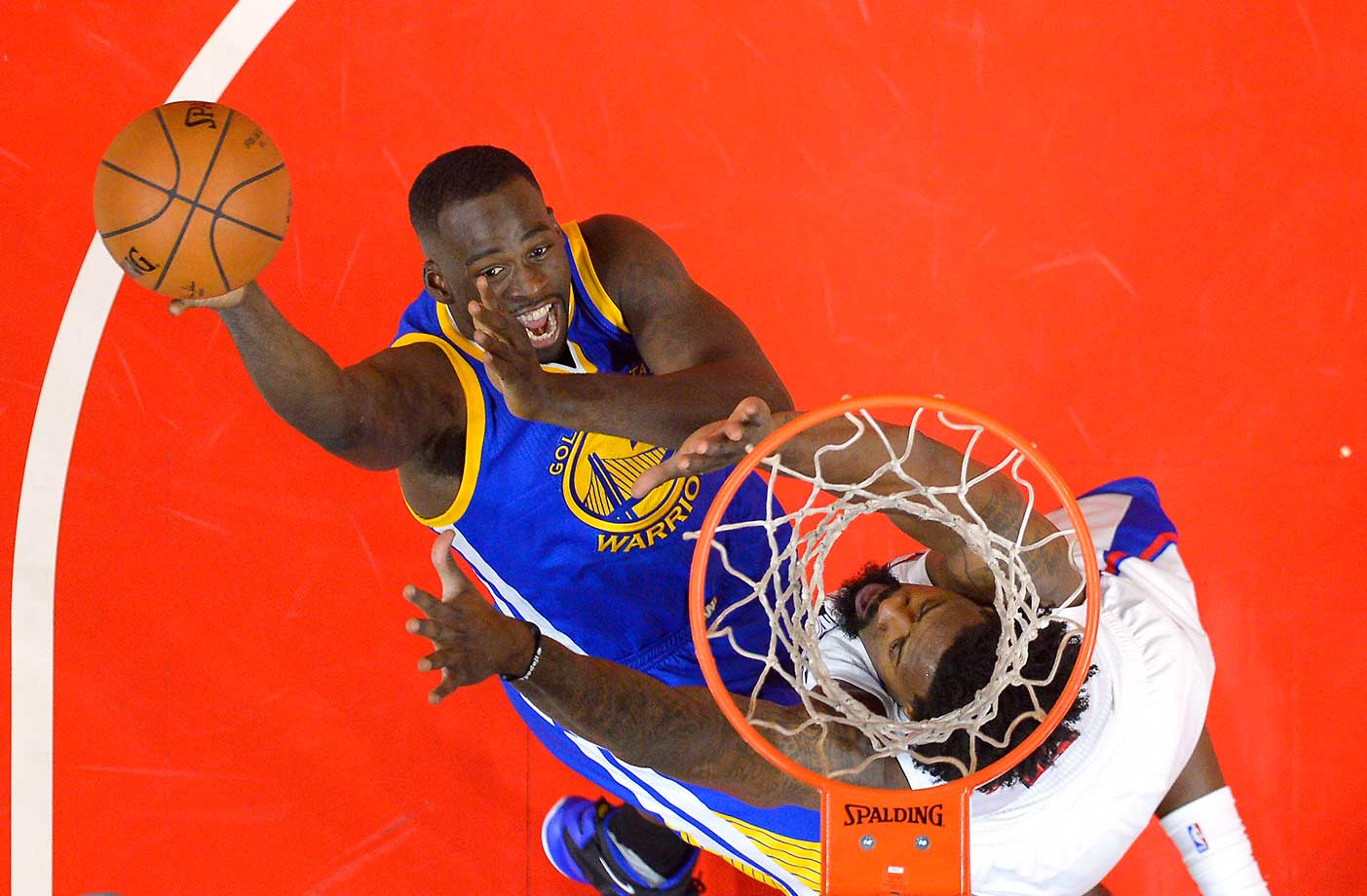 Draymond Green shoots over DeAndre Jordan as the Warriors erased a 23-point deficit to defeat the Clippers for the second time in the 2015-16 season.