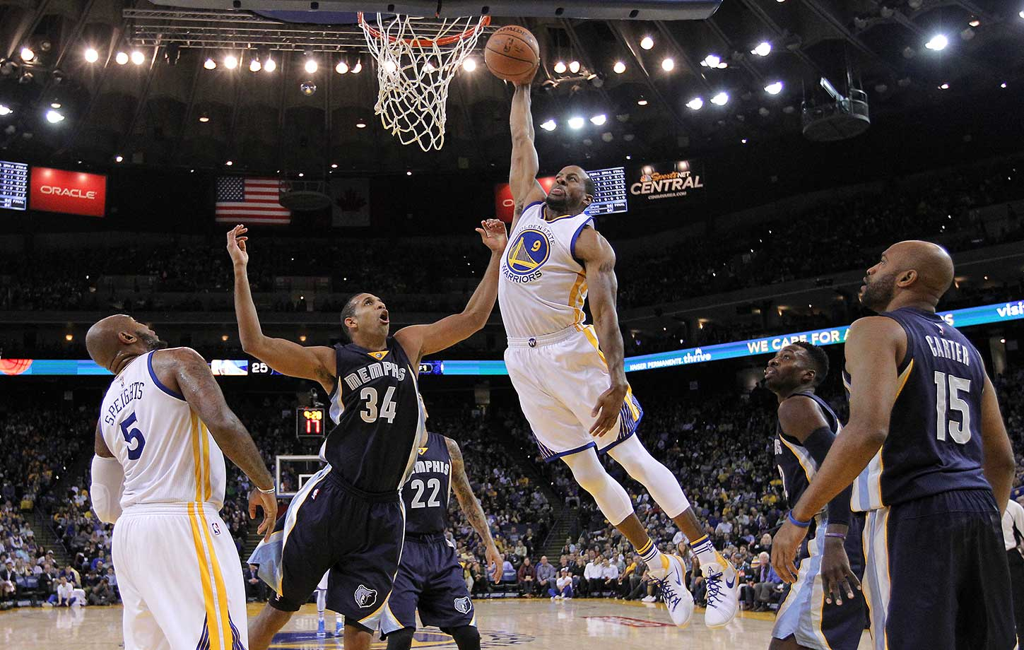 Andre Iguodala dunks over Brandan Wright in a game in which the Warriors won by 50 points, the worst loss in Memphis franchise history.