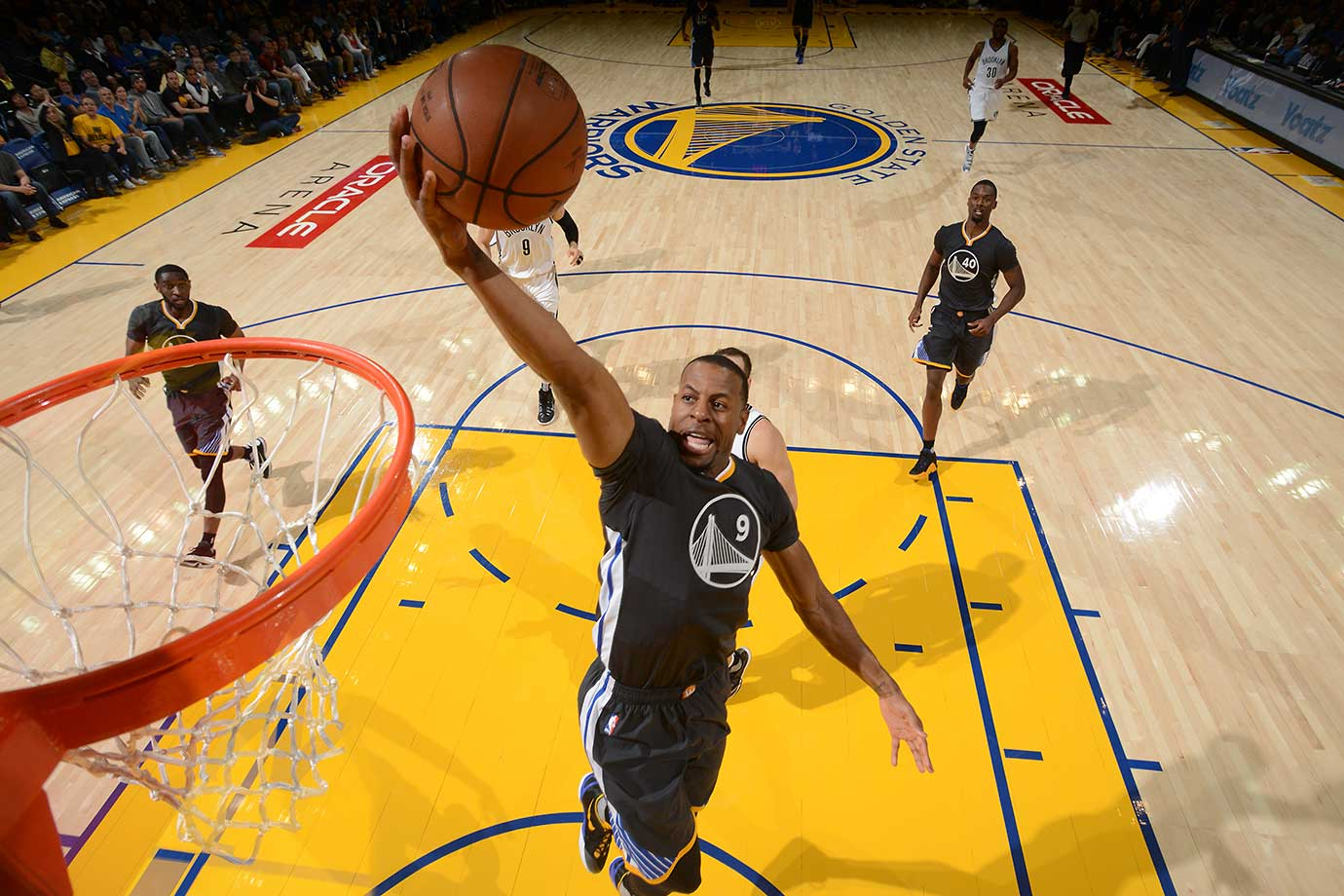 Andre Iguodala scored 18 points, including an overtime-producing three-pointer with 5.9 seconds left as the Warriors ran their record to 11-0.