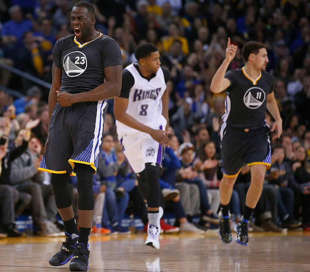 Draymond Green reacts after Klay Thompson hit a three-pointer against Sacramento. For his part, Green turned in his second consecutive triple double.