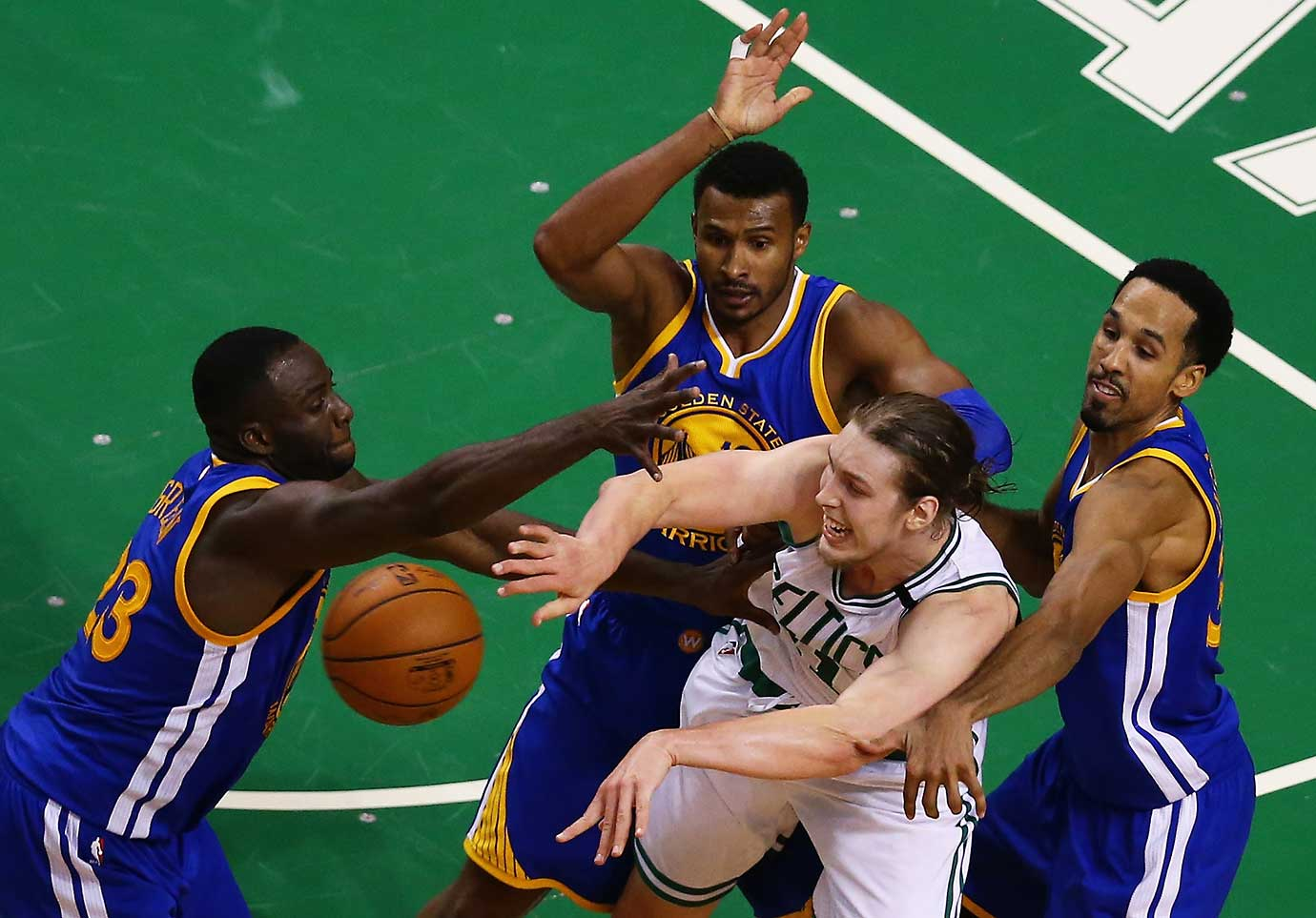 Draymond Green, Leandro Barbosa and Shaun Livingston defend Kelly Olynyk during a double overtime win over Boston.