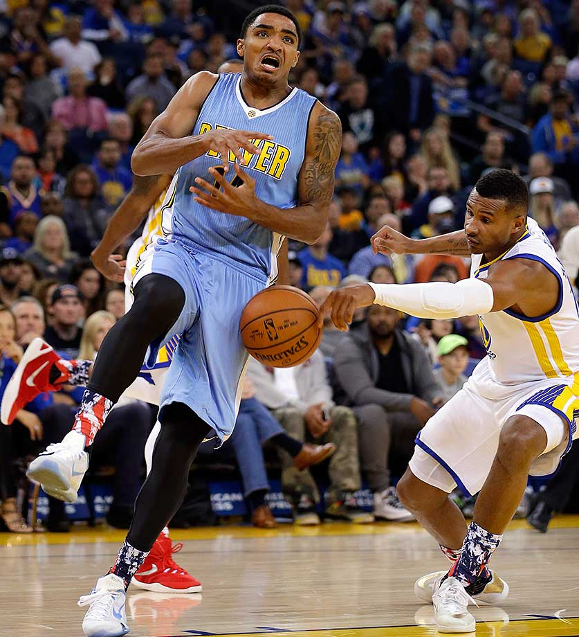 Golden State's Leandro Barbosa strips the ball from Gary Harris of the Nuggets.