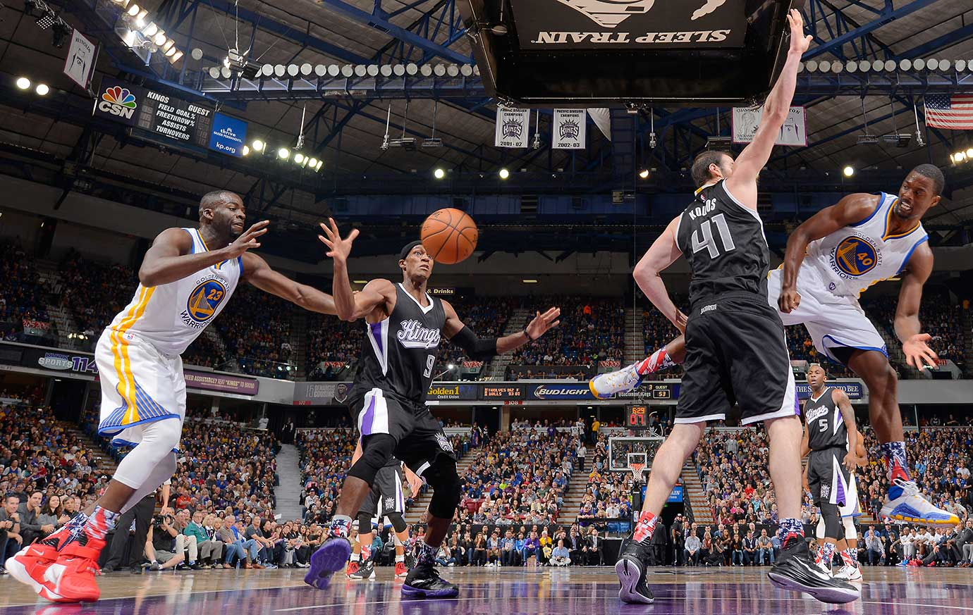 Harrison Barnes of the Warriors passes against Kosta Koufos of the Sacramento Kings.