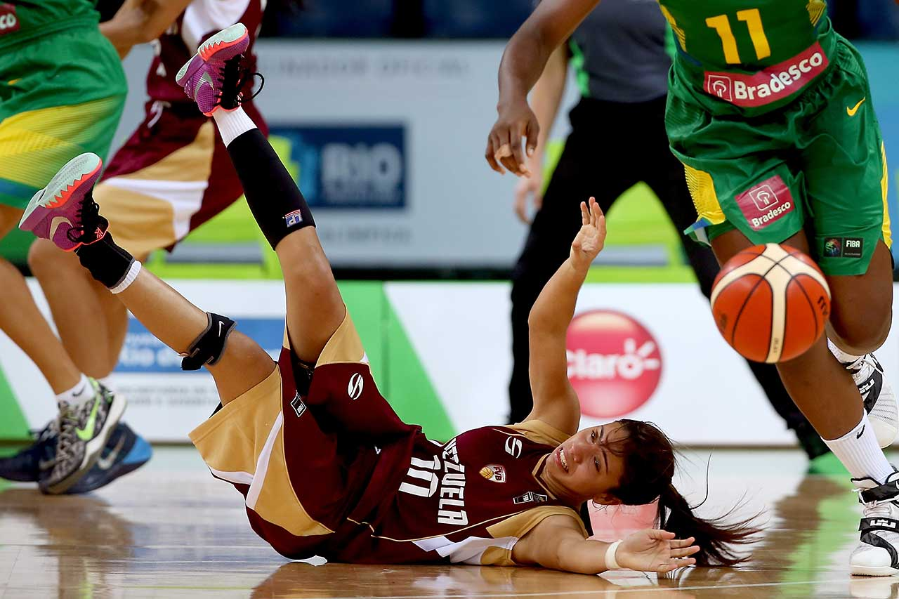 Luisana Ortega of Venezuela is stripped of the ball while playing Brazil during the International Women's Basketball Tournament, a test event for the Rio 2016 Olympics in Rio de Janeiro.