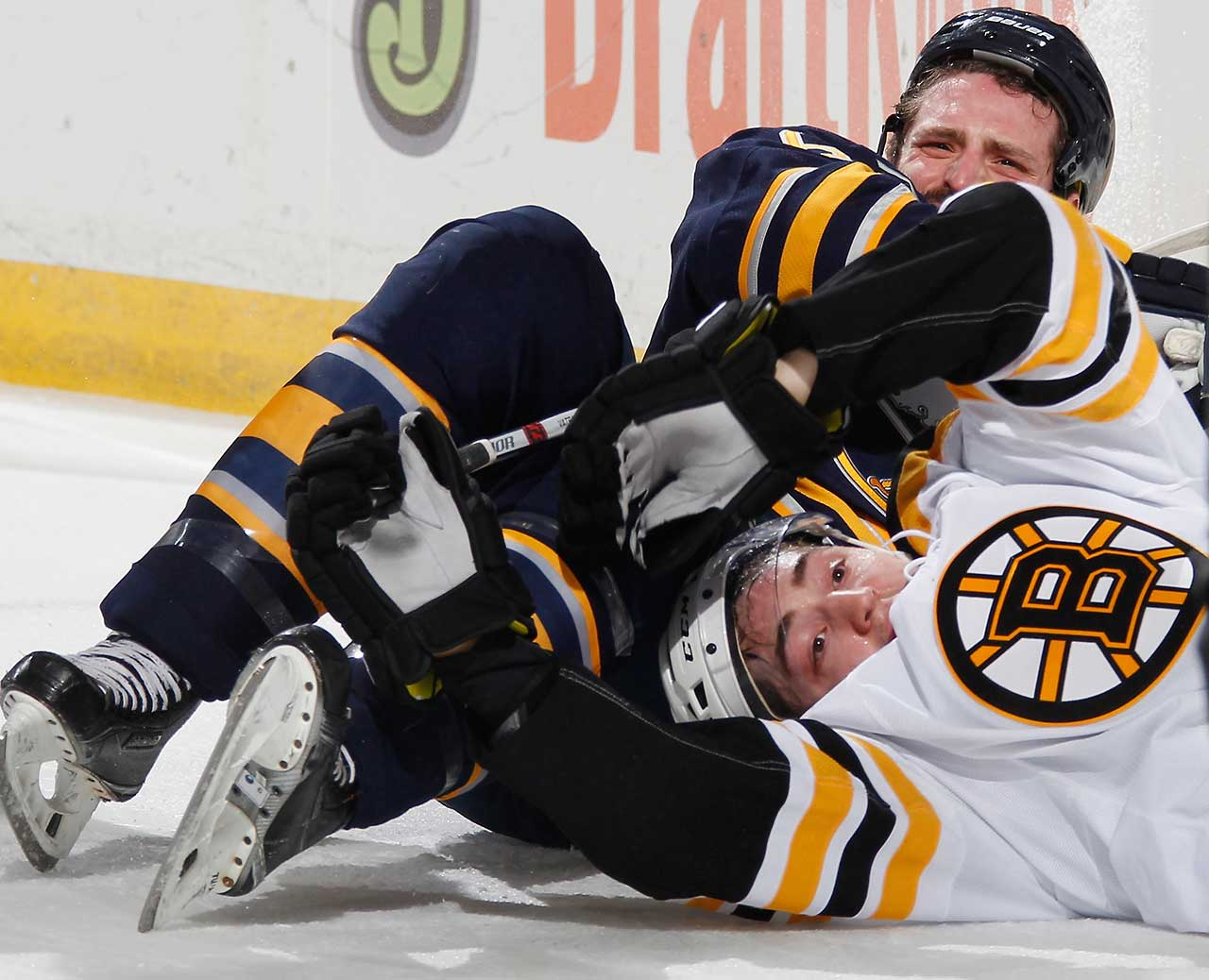 Frank Vatrano of the Boston Bruins gets tangled up on the ice with Mike Weber of the Buffalo Sabres at First Niagara Center in Buffalo.