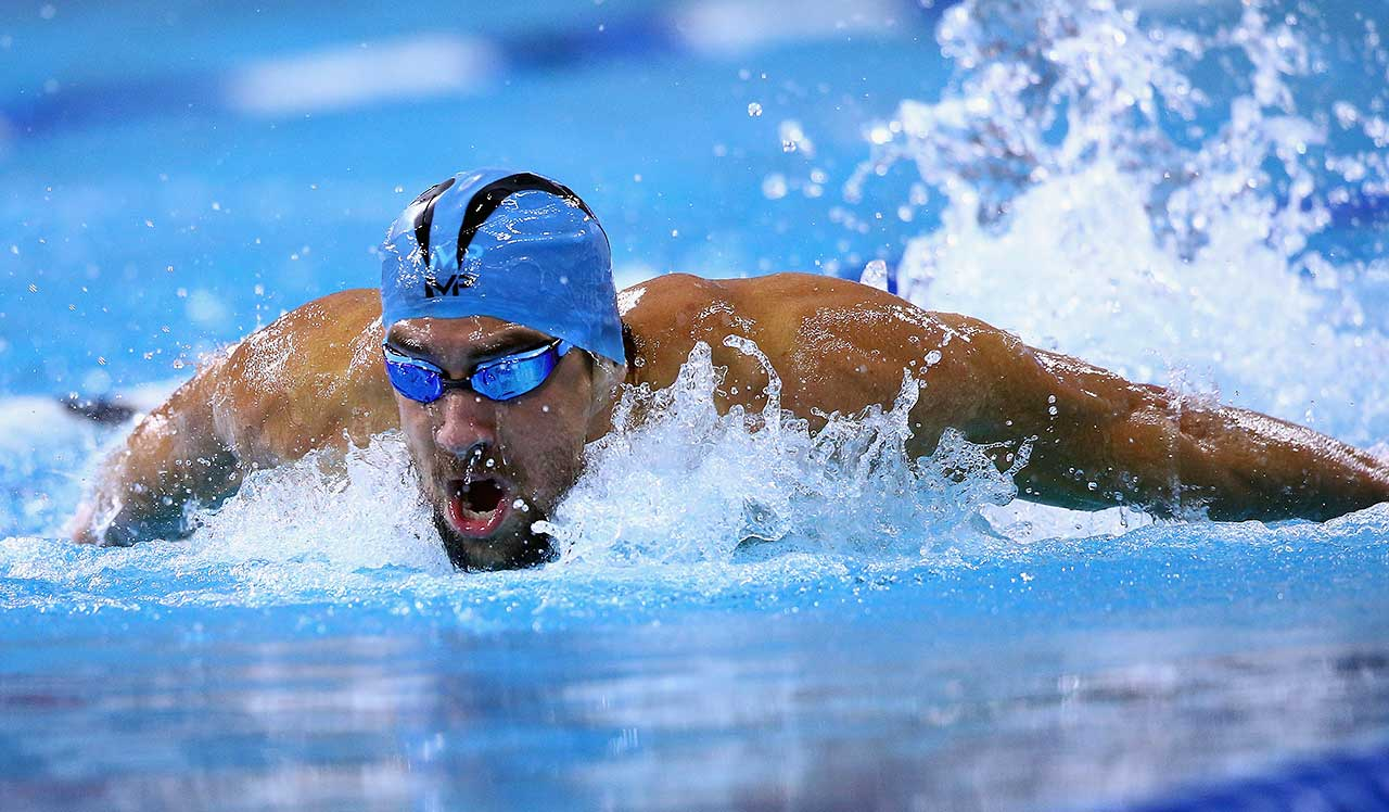 Michael Phelps swims in the 100 meter butterfly final during the Arena Pro Swim Series in Austin.