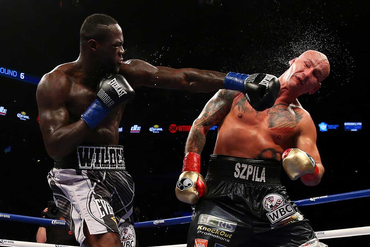 Deontay Wilder punches Artur Szpilka during their WBC heavyweight championship bout at Barclays Center in Brooklyn. Wilder won with a knockout in the ninth round.