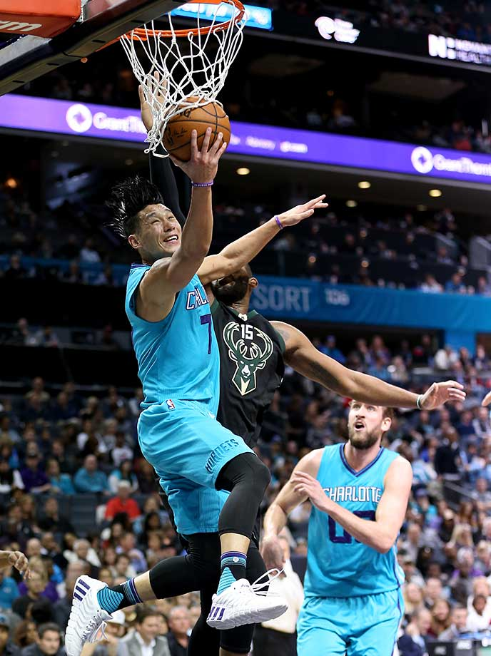Jeremy Lin of the Charlotte Hornets drives to the basket against Greg Monroe of the Milwaukee Bucks.