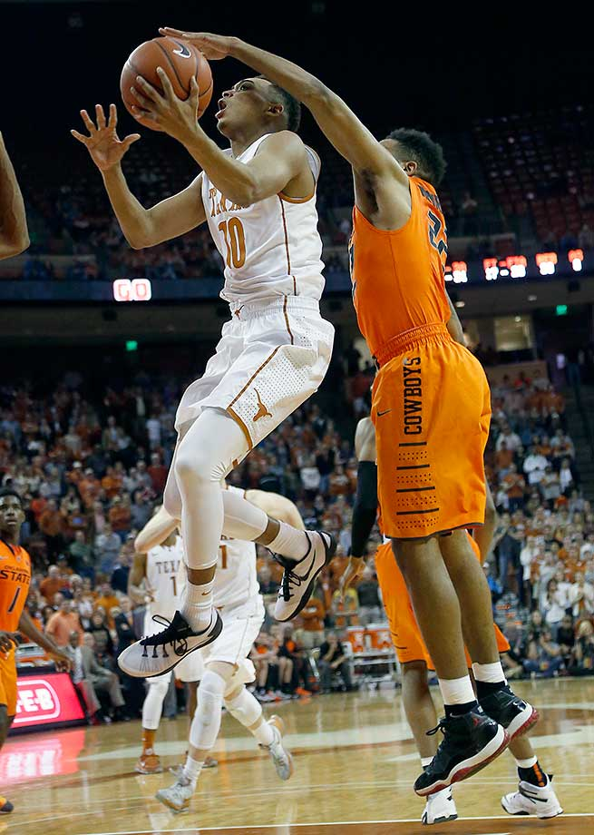 Eric Davis Jr. of the Texas Longhorns shoots the ball against Jeff Newberry of the Oklahoma State Cowboys at the Frank Erwin Center in Austin, Texas.