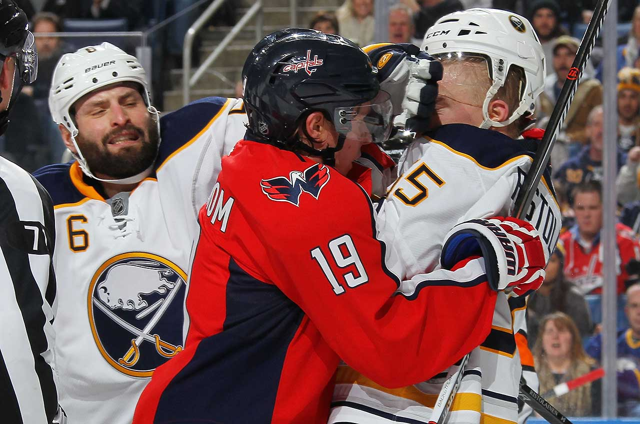 Nicklas Backstrom of the Washington Capitals and Rasmus Ristolainen of the Buffalo Sabres tussle at the First Niagara Center in Buffalo.
