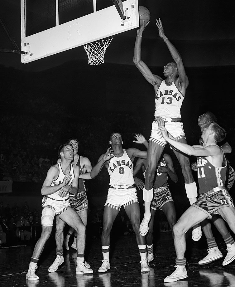 Chamberlain's skill was readily apparent from the moment he stepped foot in Lawrence. Chamberlain scored 42 points with 29 rebounds and four blocks for the freshman team playing against the Kansas varsity team. Playing his first game for the varsity the next year, he scored 52 points and grabbed 31 rebounds, a record for a player in his college debut. Chamberlain was so dominant that teams intentionally slowed the game down during his junior season and frequently triple-teamed him. He still managed to carry the Jayhawks to the championship game in 1957, scoring 23 points and 14 rebounds despite regular triple-teams in Kansas' 54-53 triple-overtime loss to North Carolina.