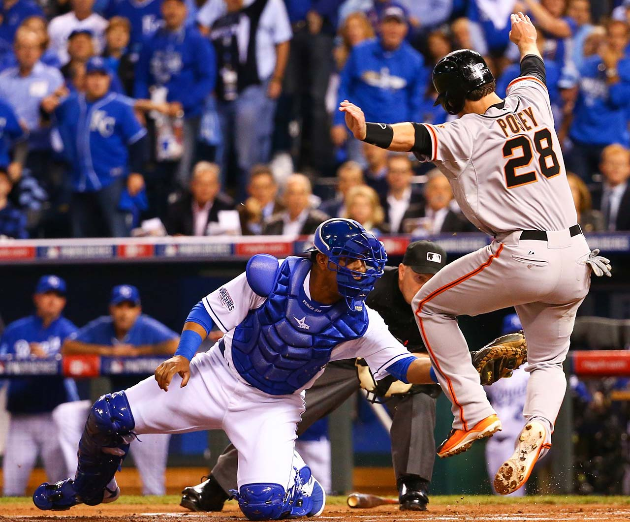 Buster Posey is tagged out by Salvador Perez while trying to score on a Pablo Sandoval double.