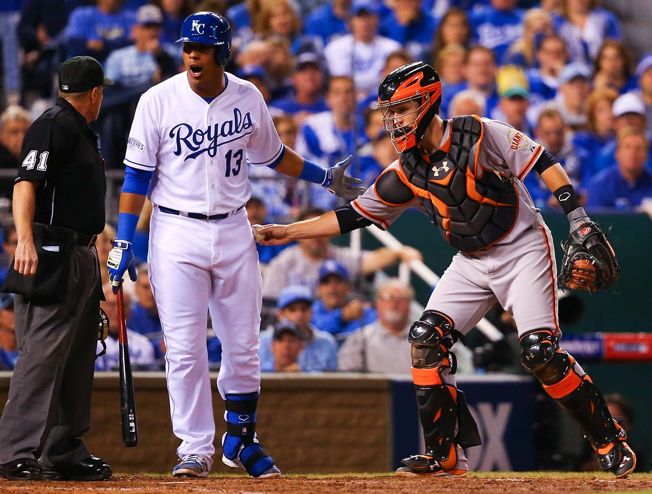 Salvador Perez argues with the umpire as he is tagged by Buster Posey.