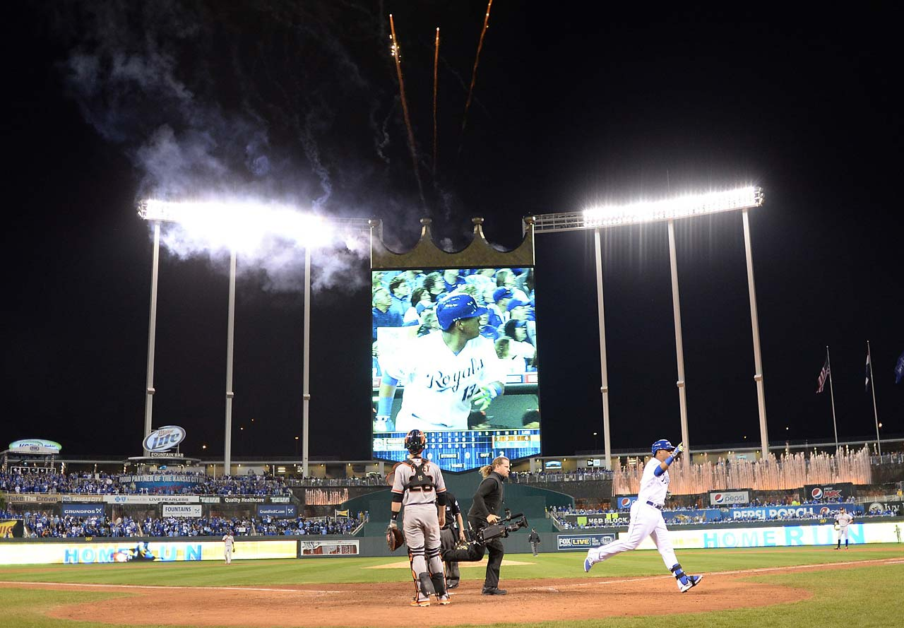 A video cameraman follows Perez across home plate after the catcher scored the Royals only run of the night.