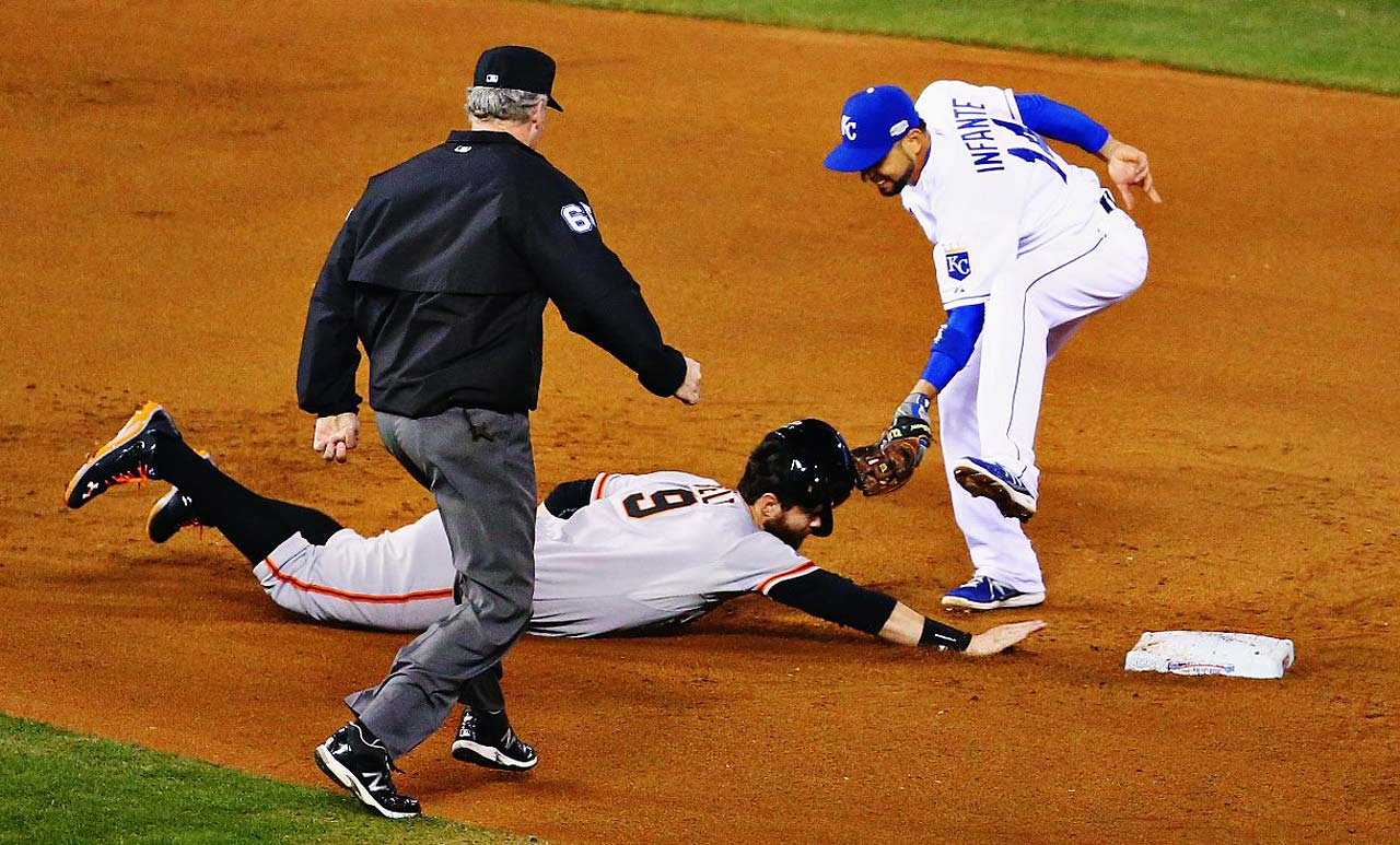 Brandon Belt is tagged out at second by Omar Infante after going halfway to third on a flyout to right.