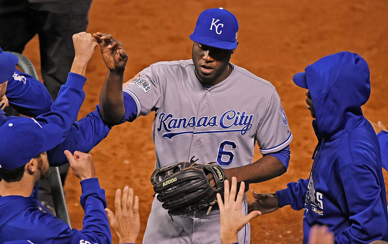 Lorenzo Cain is greeted by teammates after making a terrific running catch.