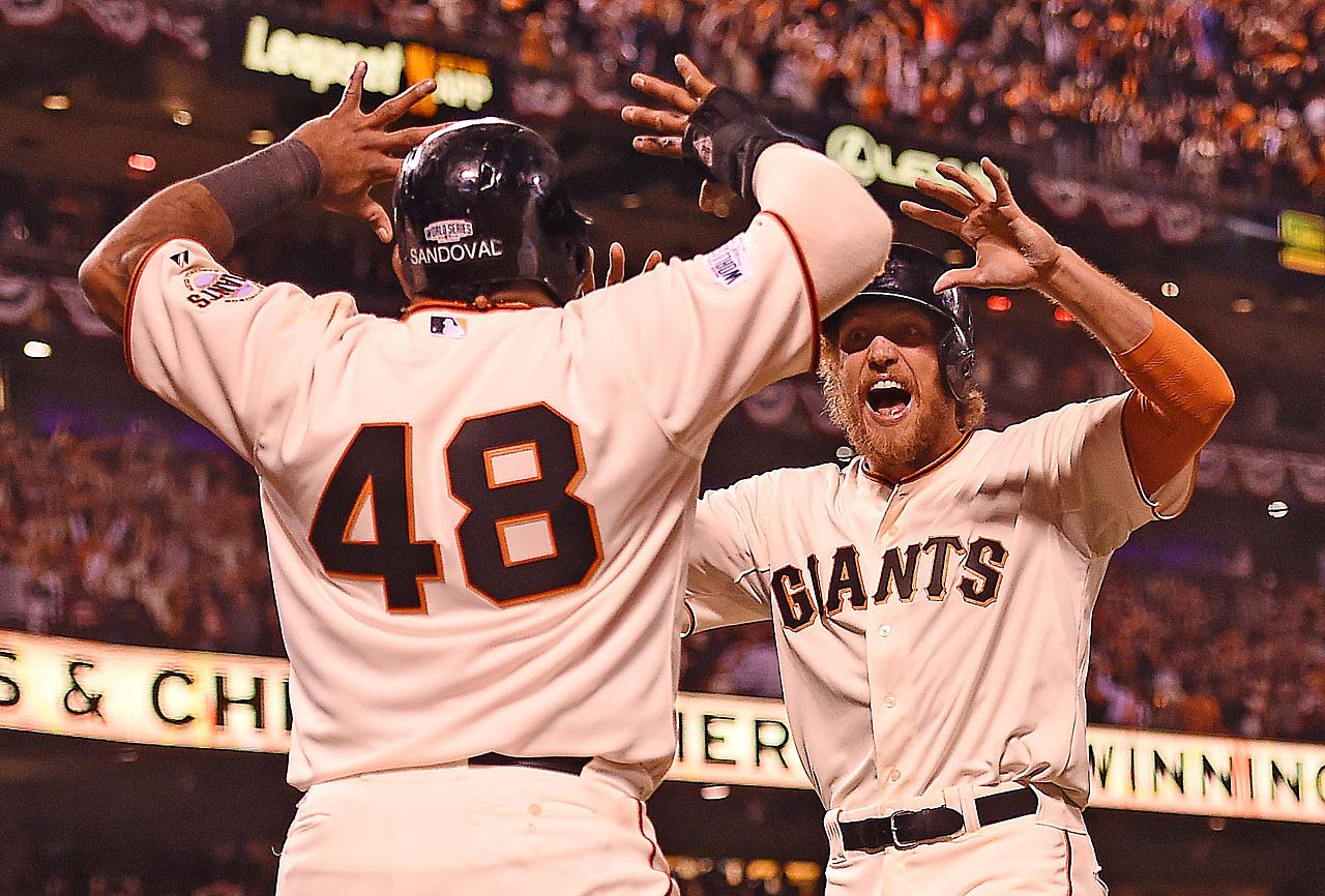 Pablo Sandoval and Hunter Pence celebrate as the Giants pad a 2-0 lead by scoring three times in the eighth inning.