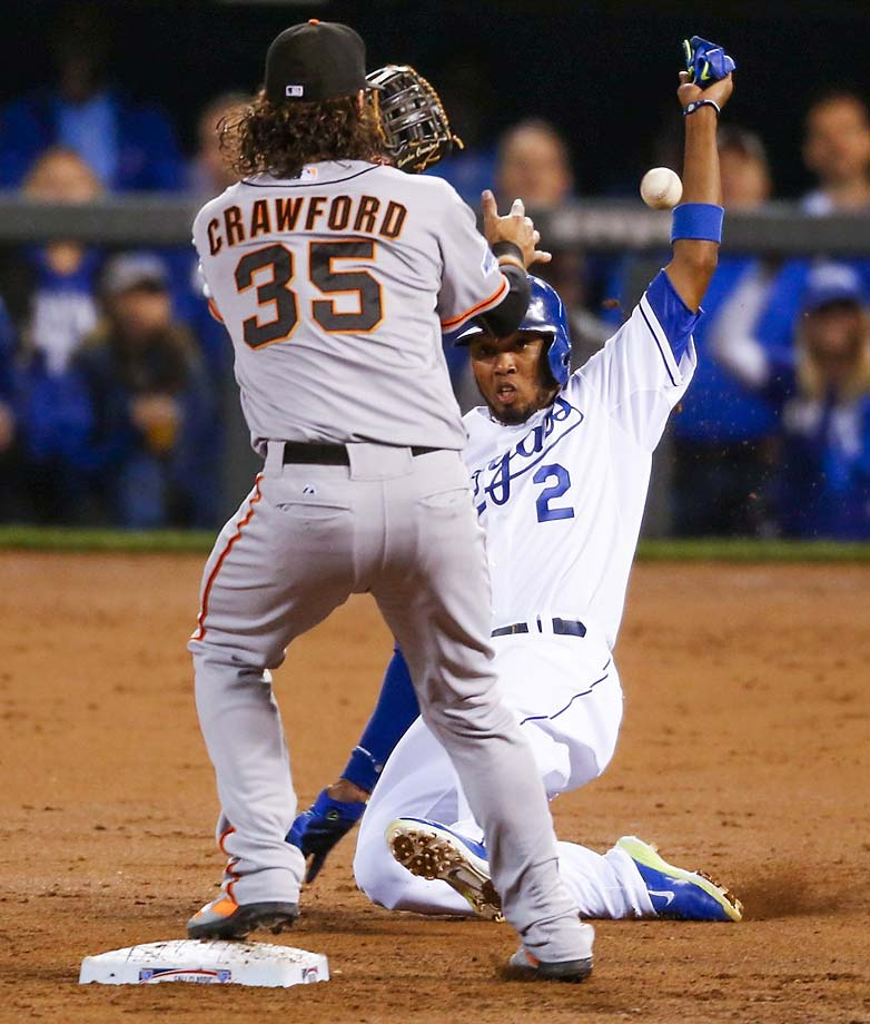 Alcides Escobar is forced out at second by Brandon Crawford.