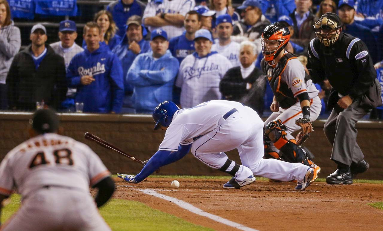 Royals catcher Sandoval Perez falls down in pain after being hit above the knee in the second inning.
