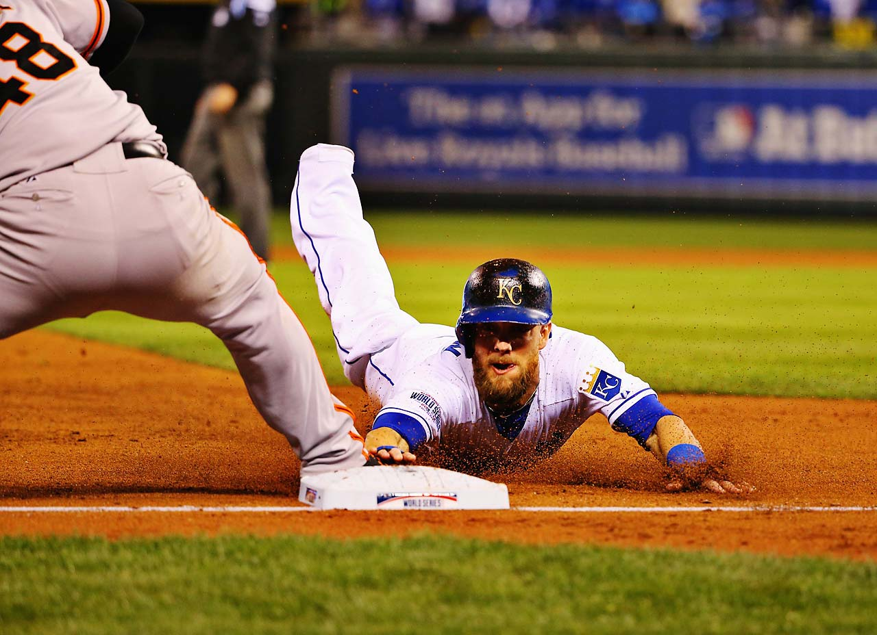 Hunter Pence slides into third safely after a fly ball to left.