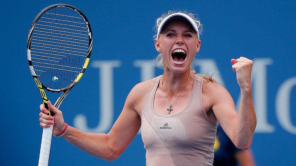 Caroline Wozniacki was sharp, getting past Maria Sharapova and into the quarterfinals of the U.S. Open.