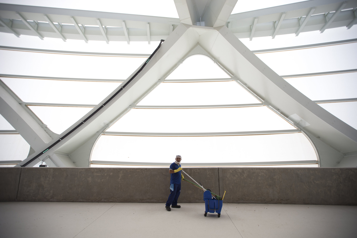 A janitor sweeps the inside of the Arena da Amazonias in preparation for the World Cup in Manaus.