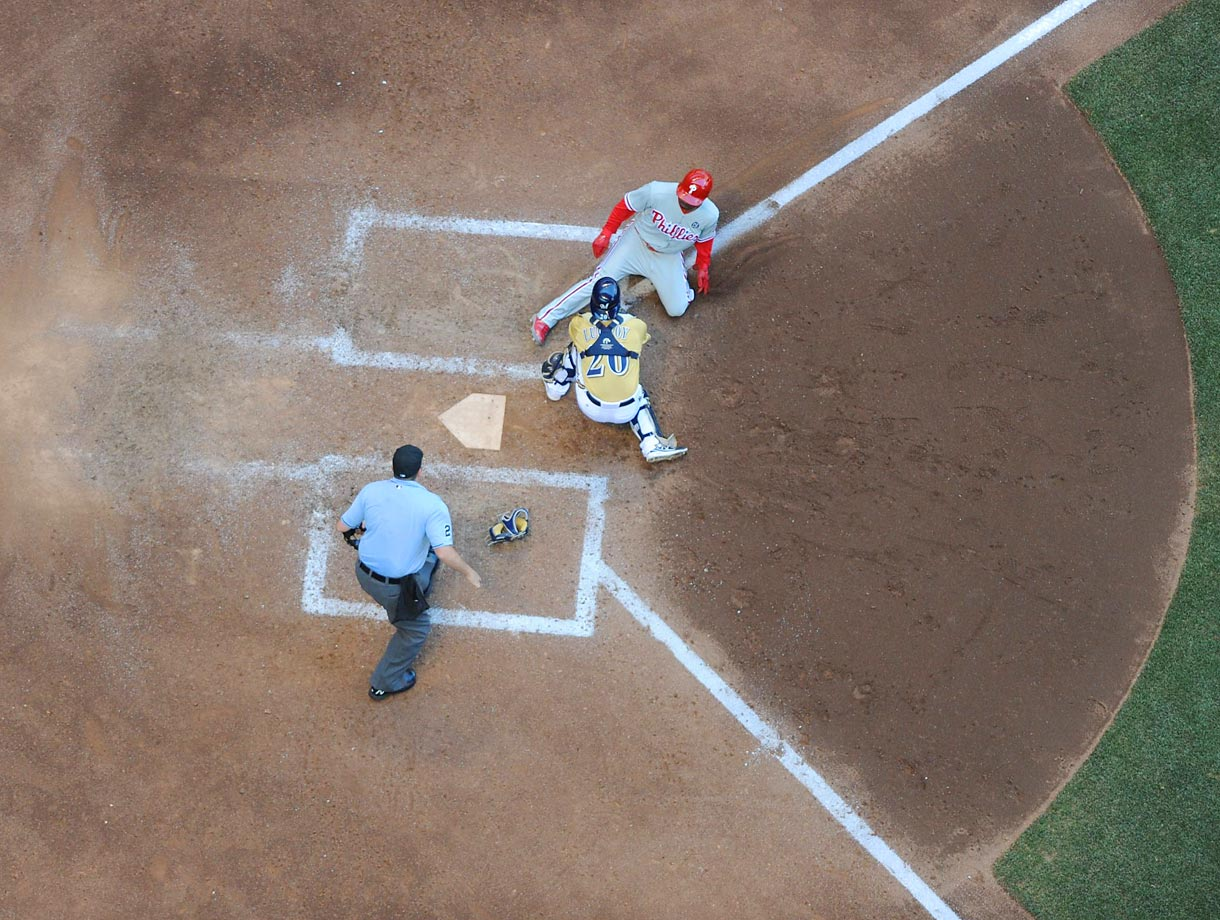 Milwaukee Brewers catcher Jonathan Lucroy tags out a Philadephia Phillies baserunner during a game at Miller Park in Milwaukee, Wis., on July 10, 2014.