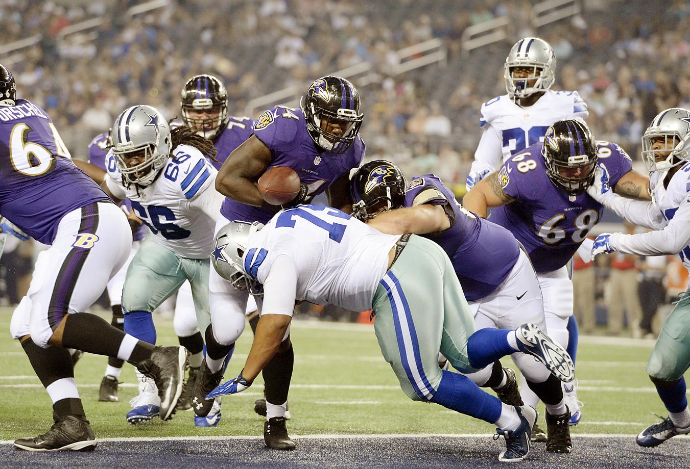 Lorenzo Taliaferro of the Ravens loses a grip on the ball during a preseason game against the Cowboys.  Baltimore won 37-30.