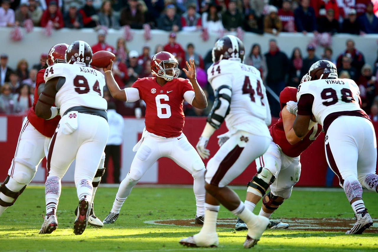 Quarterback Blake Sims of Alabama throws a pass in the first half against Mississippi State.