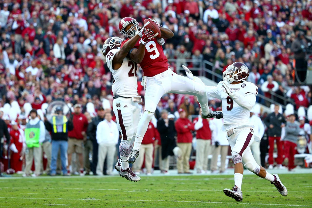 Amari Cooper of Alabama makes a 50-yard reception in the second quarter against Kendrick Market (26) and Justin Cox (9) of Mississippi State.