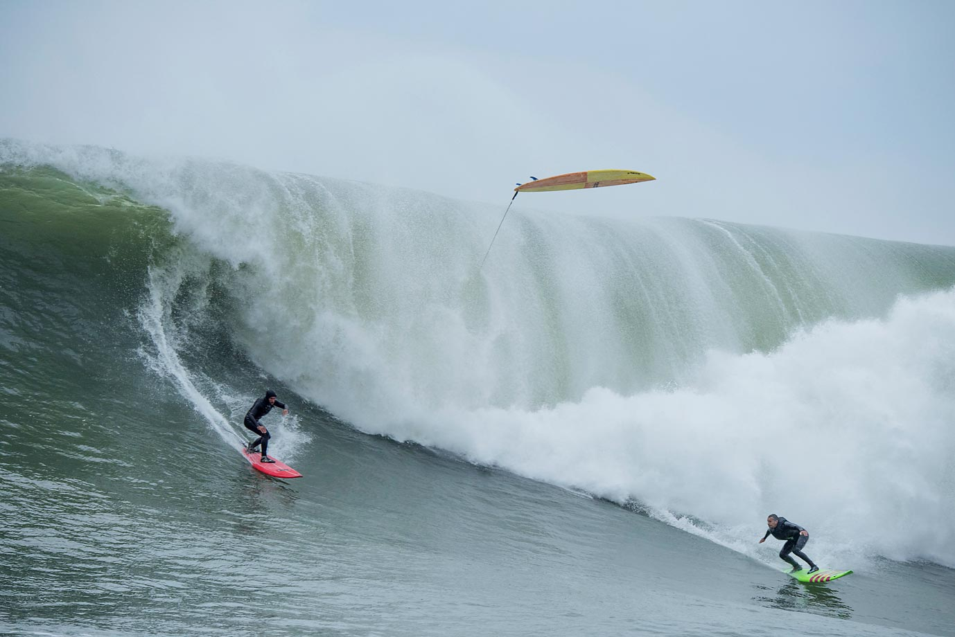 Garrett McNamara (right) rides Mavericks.