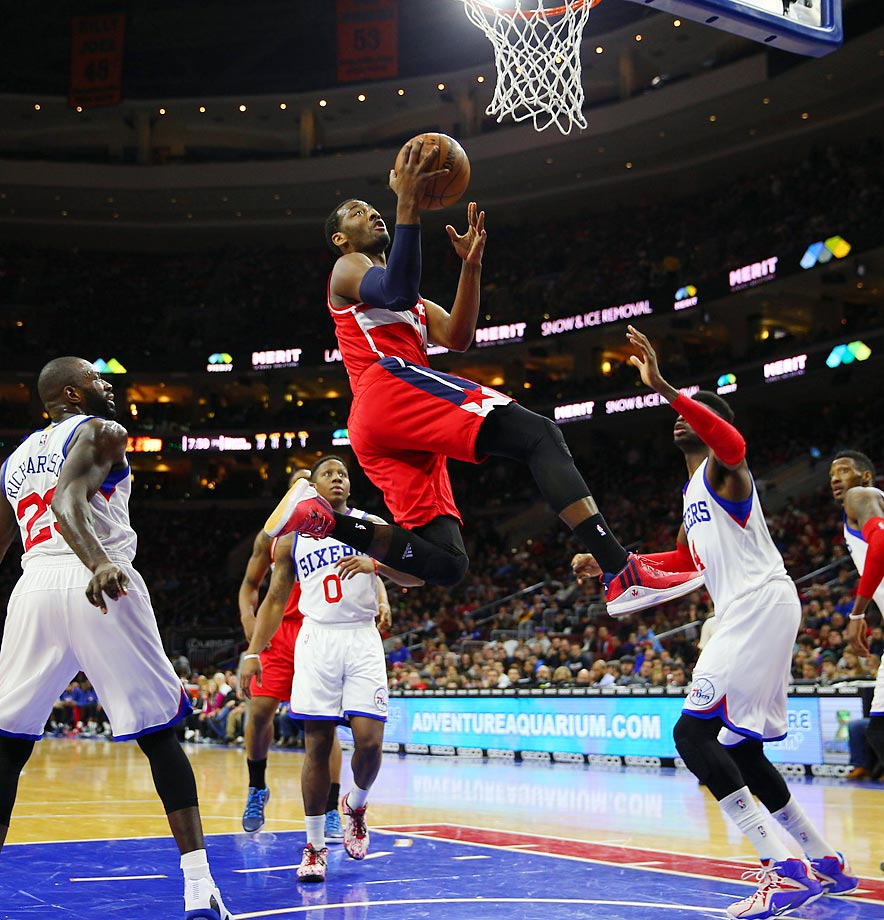 Washington Wizards point guard John Wall drives to the hoop during a game against the Philadelphia 76ers.