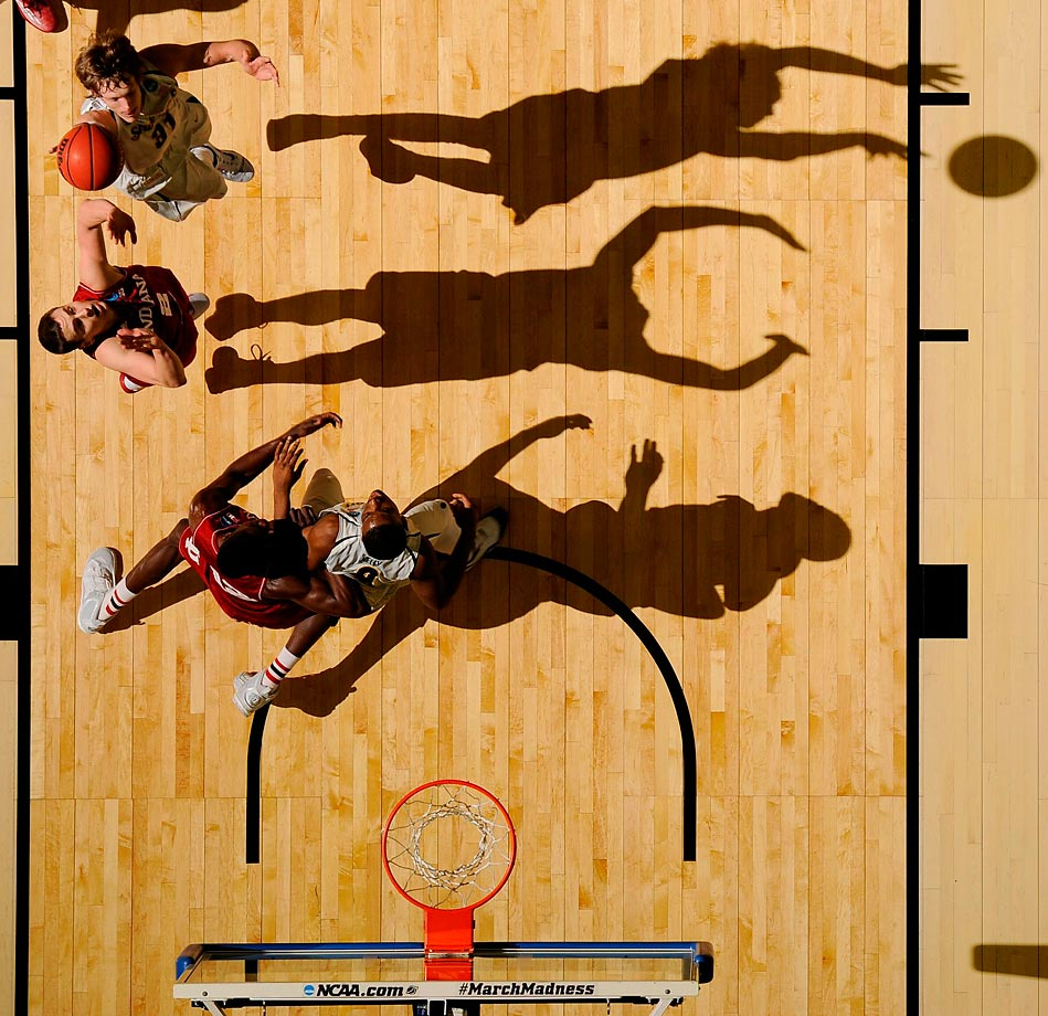Shadows surround as Ron Baker of Wichita State lofts a runner over Indiana.