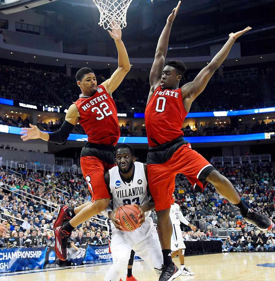 Two North Carolina defenders mis-timed their jump against Villanova.