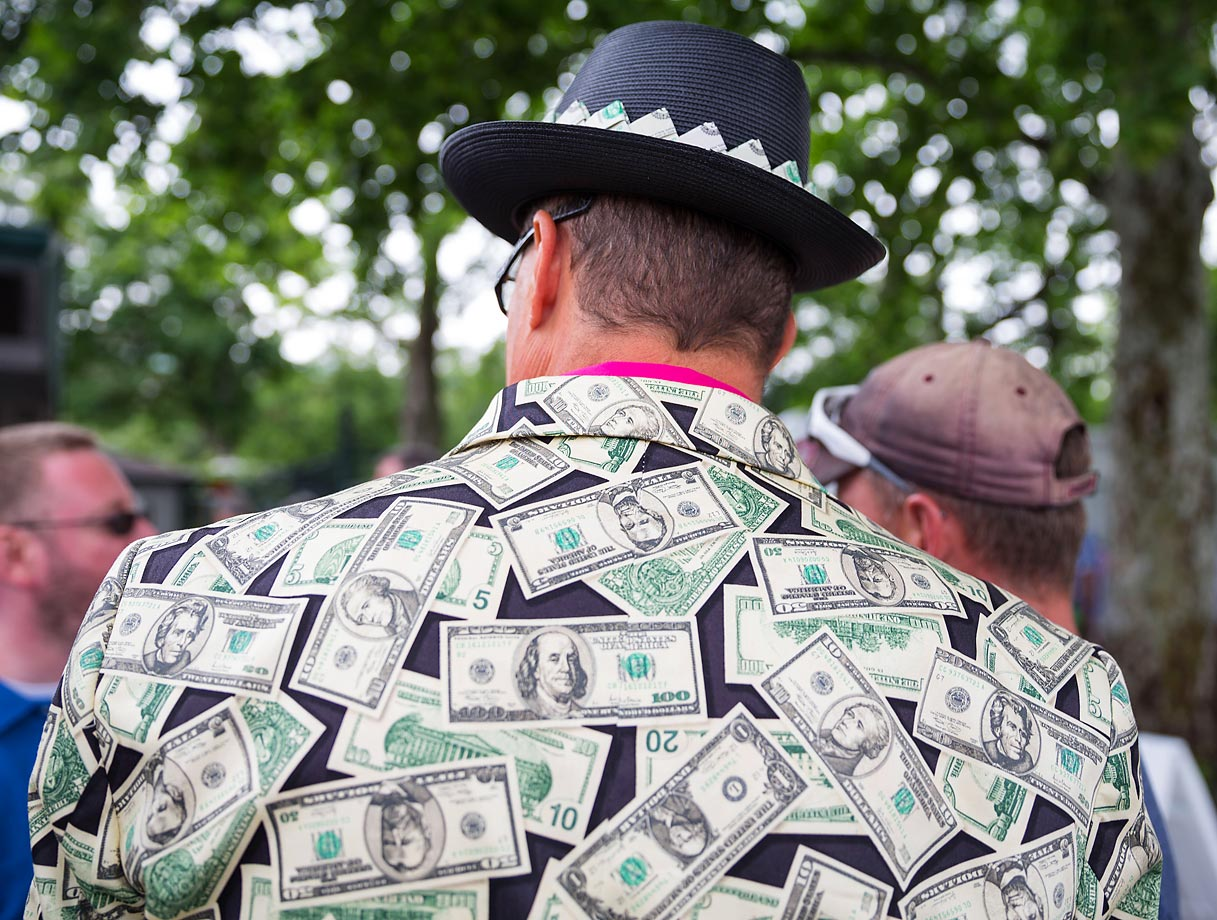 A fan comes to the Belmont Stakes decked out in dollar bills on June 6 in Elmont, N.Y.