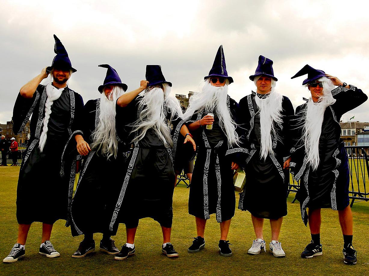 British Open fans dressed as wizards in the wind.