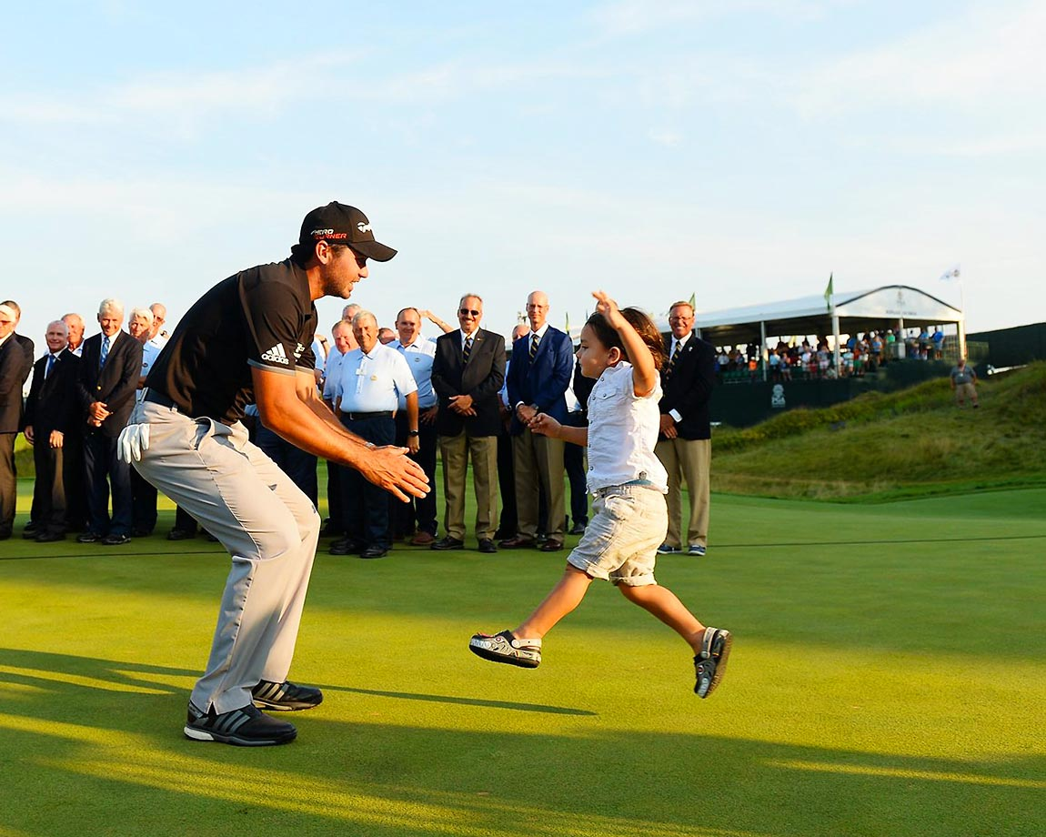 Jason Day with his son Dash after winning the PGA Championship.
