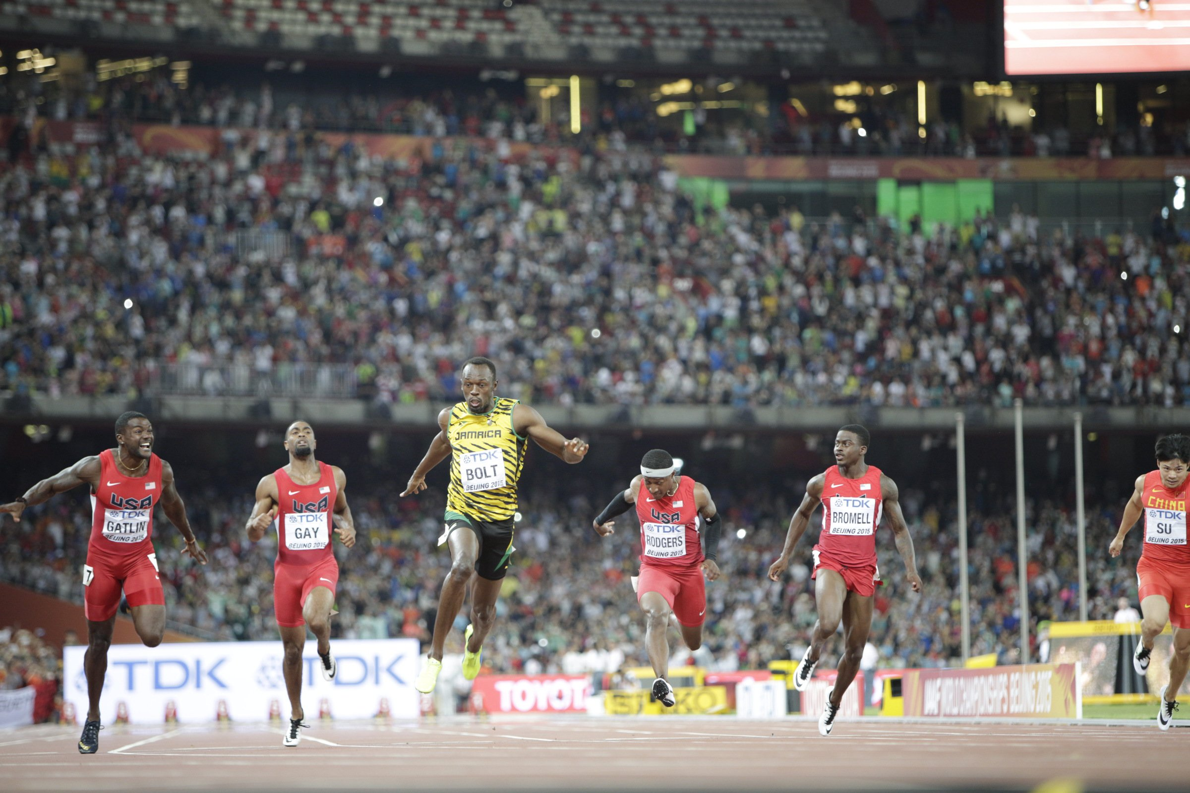 Usain Bolt (JAM) ran his fastest time of the year to fend off Justin Gatlin (USA) and other Americans in the world championship 100-meter final.