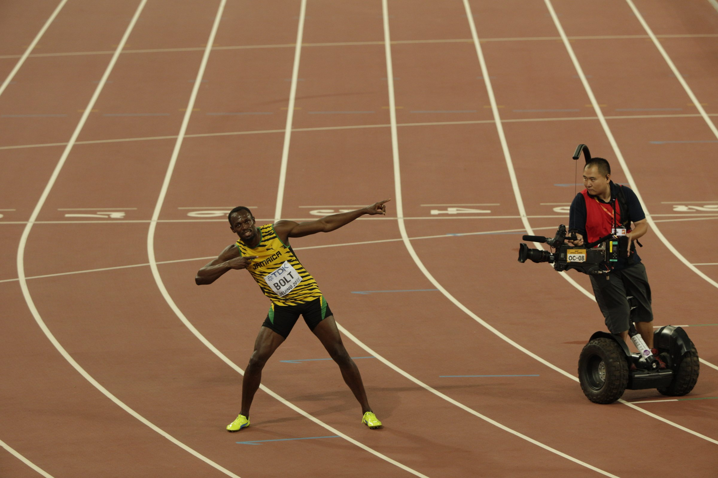 A videographer captures Usain Bolt's signature celebration after the men's 100-meter final.
