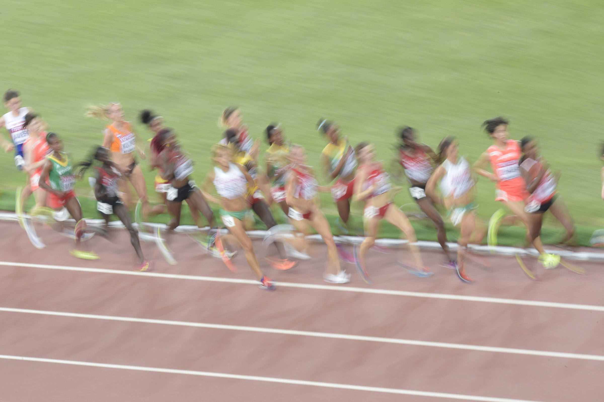 A tightly-bunched pack of competitors await a surge in pace in the women's 10,000-meter run.