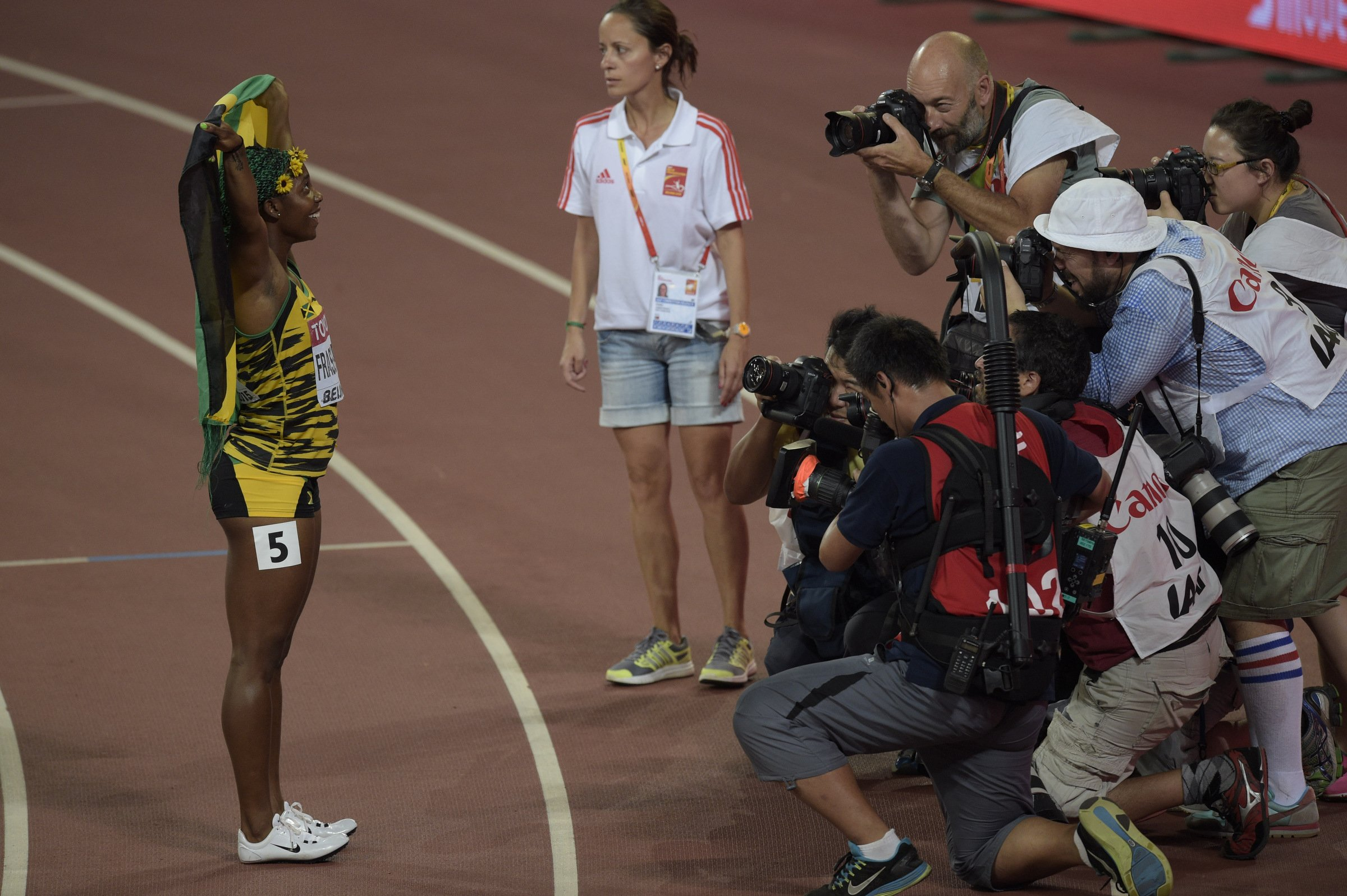 Shelly-Ann Fraser-Pryce (JAM) celebrates her third world championship gold medal in the 100-meters.